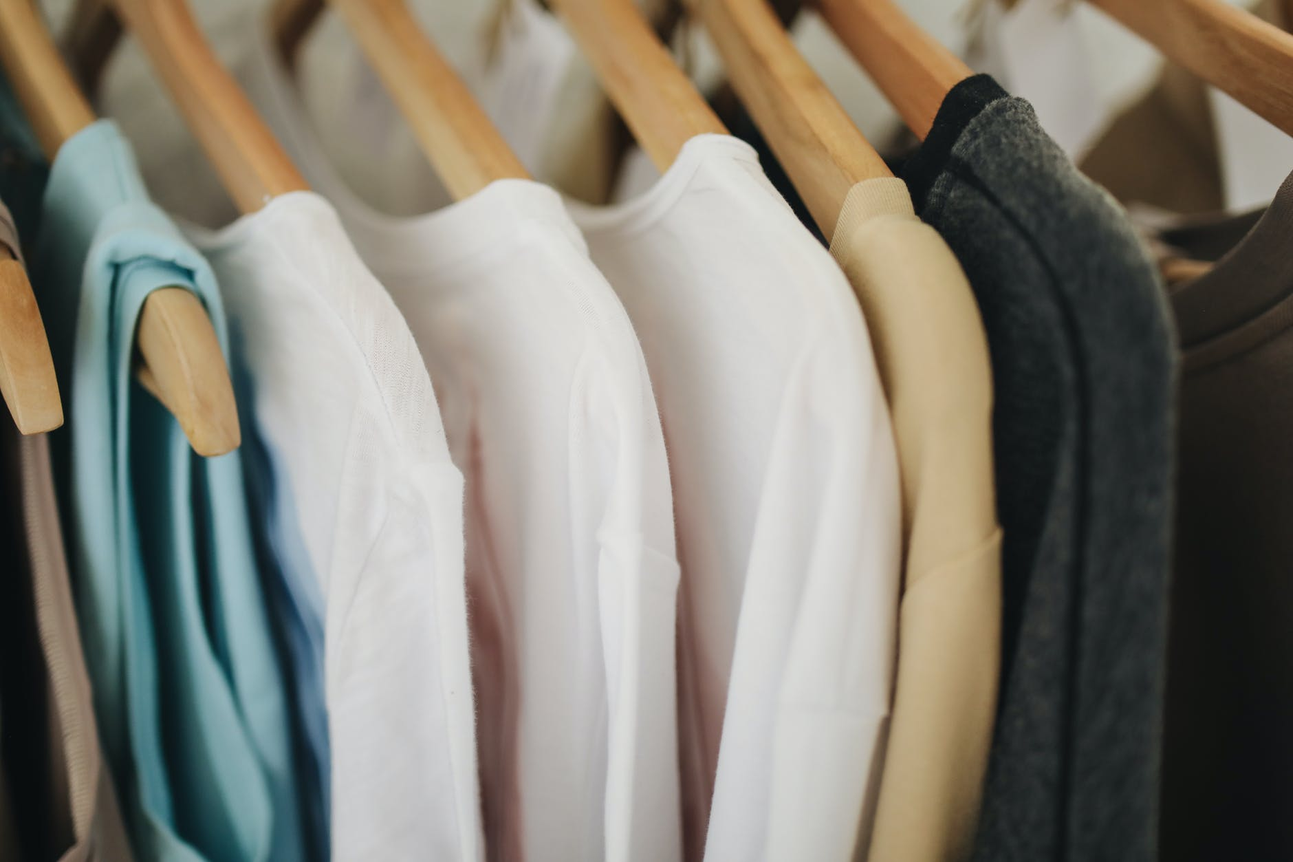white long sleeves shirts on brown wooden clothes hanger