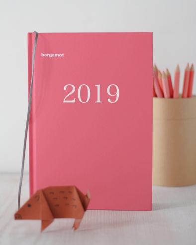 コーラルピンクの手帳